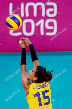 Stock Photo of Colombia's captain Maria Marin defends in the gold medal women's volleyball match against Dominican Republic at the Pan American Games in Lima, Peru