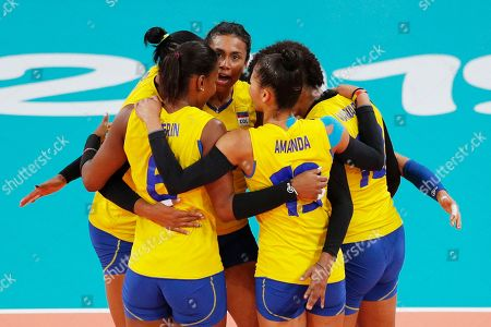Colombia's captain Maria Marin talks to teammates during their gold medal women's volleyball match against Dominican Republic at the Pan American Games in Lima, Peru