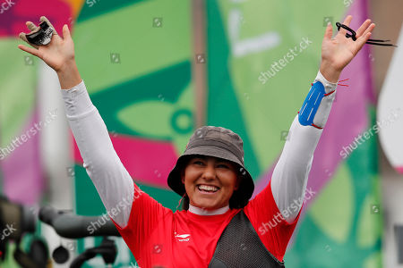 Stock Photo of Alejandra Valencia of Mexico celebrates winning the gold medal against Khatuna Lorig of the United States in the women's archery recurve individual final at the Pan American Games in Lima, Peru