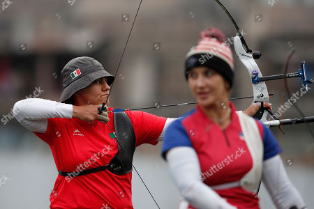 Alejandra Valencia of Mexico, left, competes to win the gold medal against Khatuna Lorig of the United States in the women's archery recurve individual final at the Pan American Games in Lima, Peru