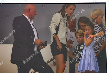 COWES, ENGLAND. 08 AUGUST Catherine, Duchess of Cambridge looks on with Prince George and Princess Charlotte, during the SailGP race weekend held in Cowes, Isles of Wight, UK