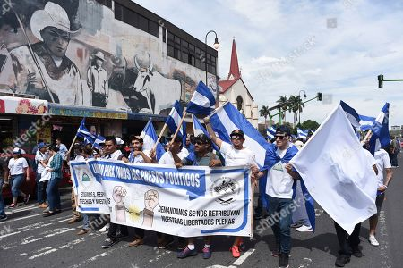 Nicaraguan refugees living in Costa Rica march against the government of Nicaraguan President Daniel Ortega, in San Jose, Costa Rica, . Nicaragua's crisis erupted in April 2018 with protests that grew to demand Ortega's exit from office and early elections. A crackdown on the demonstrations resulted in at least 325 dead, over 2,000 wounded, hundreds imprisoned and tens of thousands fleeing to exile, according to the Inter-American Commission on Human Rights