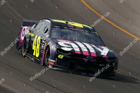 Jimmie Johnson races with damage to his car during a NASCAR Cup Series auto race at Michigan International Speedway in Brooklyn, Mich