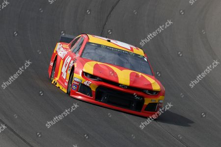Kyle Larson races during a NASCAR Cup Series auto race at Michigan International Speedway in Brooklyn, Mich