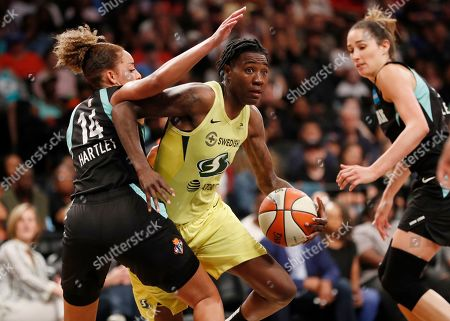 Stock Picture of Bria Hartley, Natahsa Howard, Rebecca Allen. New York Liberty guard Bria Hartley (14) defends against Seattle Storm forward Natasha Howard, center, during the second half of a WNBA basketball game, in New York. Liberty forward Rebecca Allen, right, looks on