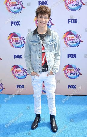 Hayden Summerall arrives at the Teen Choice Awards, in Hermosa Beach, Calif