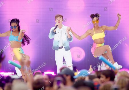 Johnny Orlando, center, performs at the Teen Choice Awards, in Hermosa Beach, Calif