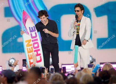 John Stamos, David Dobrik. John Stamos, right, presents the choice male web star award to David Dobrik at the Teen Choice Awards, in Hermosa Beach, Calif