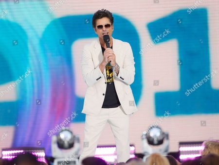 John Stamos presents the choice male web star award at the Teen Choice Awards, in Hermosa Beach, Calif