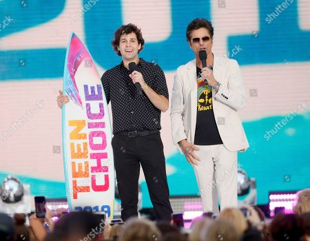 John Stamos, David Dobrik. David Dobrik, left, accepts the award for choice male web star as John Stamos looks on at the Teen Choice Awards, in Hermosa Beach, Calif