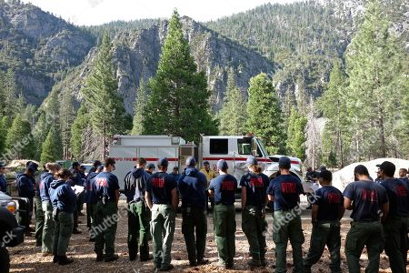 Stock Image of Burn boss Andrew Cremers briefs firefighters from Sequoia and Kings Canyon National Parks before the start of a two-day prescribed burn in Cedar Grove in Kings Canyon National Park, Calif. The prescribed burn, a low-intensity, closely managed fire, was intended to clear out undergrowth and protect the heart of Kings Canyon National Park from a future threatening wildfire. The tactic is considered one of the best ways to prevent the kind of catastrophic destruction that has become common, but its use falls woefully short of goals in the West