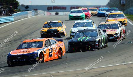 Brad Keselowski (2) and Kurt Busch (1) head into Turn 1 during a NASCAR Cup Series auto race at Watkins Glen International, in Watkins Glen, N.Y