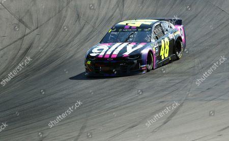 Jimmie Johnson heads into Turn 1 during a NASCAR Cup Series auto race at Watkins Glen International, in Watkins Glen, N.Y