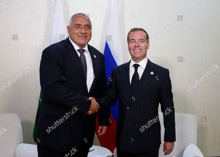 Bulgarian Prime Minister Boyko Borissov (L) shakes hands with Russian Prime Minister Dmitry Medvedev (R) as they pose for a photo prior to their bilateral meeting on the sidelines of the First Caspian Economic Forum in Turkmenbashi, Turkmenistan, 12 August 2019.