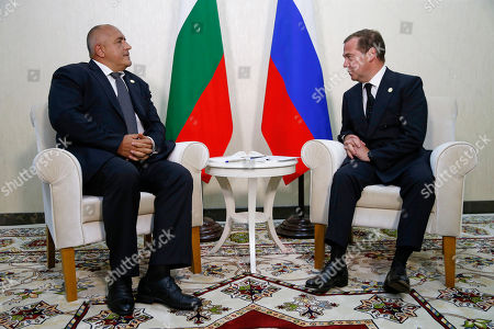 Bulgarian Prime Minister Boyko Borissov (L) and Russian Prime Minister Dmitry Medvedev (R) meet on the sidelines of the First Caspian Economic Forum in Turkmenbashi, Turkmenistan, 12 August 2019.