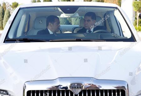 Russian Prime Minister Dmitry Medvedev (L) and Turkmenistan's President Gurbanguly Berdimuhamedow (R) sit inside a Russian-built limousine Aurus Senat before a session of the First Caspian Economic Forum in Turkmenbashi, Turkmenistan, 12 August 2019.