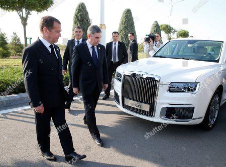 Russian Prime Minister Dmitry Medvedev (L) and Turkmenistan's President Gurbanguly Berdimuhamedow (front 2-L) inspect a Russian-built limousine Aurus Senat before a session of the First Caspian Economic Forum in Turkmenbashi, Turkmenistan, 12 August 2019.