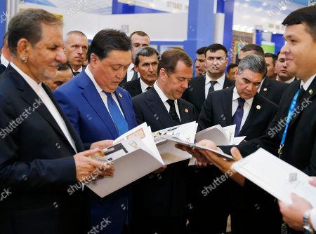 (L-R, front) Iranian Vice President Eshaq Jahangiri, Kazakh Prime Minister Askar Mamin, Russian Prime Minister Dmitry Medvedev and Turkmenistan's President Gurbanguly Berdimuhamedow attend the Caspian exhibition of Innovative Technologies within the framework of the First Caspian Economic Forum in Turkmenbashi, Turkmenistan, 12 August 2019.