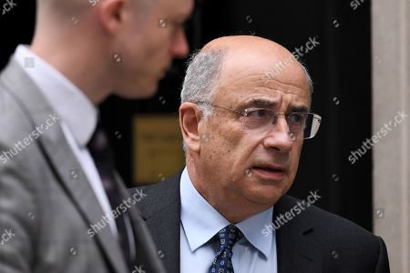 Lord Leveson leaves No.10 Downing Street after an urgent review of sentencing policy.