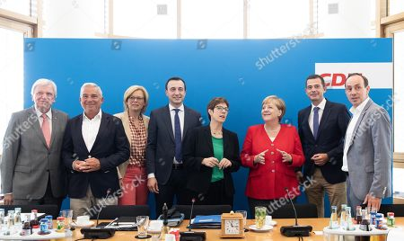 Stock Photo of (L-R) Premier of Hesse Volker Bouffier, vice-chairman Thomas Strobl, Minister of Food and Agriculture Julia Kloeckner, Secretary General Paul Ziemiak, chairwoman Annegret Kramp- Karrenbauer, German Chancellor Angela Merkel and CDU's parliamentary group leaders Mike Mohring of Thuringia and Ingo Senftleben of Brandenburg talk during a board meeting of the Christian Democratic Union (CDU) at CDU?s headquarters in Berlin, Germany, 12 August 2019.