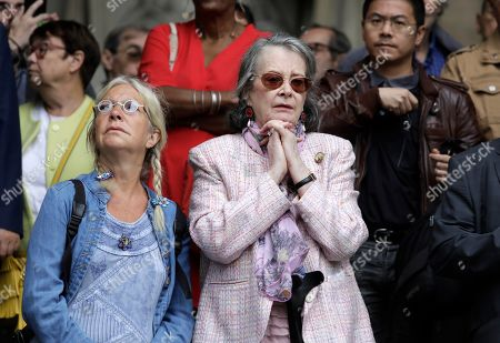 Stock Picture of French actress Dominique Lavanant, center, gestures as she leaves after the funeral of French film director Jean Pierre Mocky at Saint Sulpice church in Paris