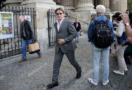 Actor Benoit Magimel leaves after the funeral of French film director Jean-Pierre Mocky at Saint Sulpice church in Paris, . Film celebrities, a culture minister and fans have paid homage to Jean-Pierre Mocky, a fiercely independent filmmaker who directed some of France's most famed actors over a six-decade career