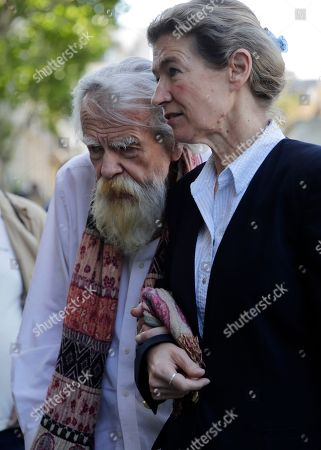 French/British actor Michael Lonsdale, right, leaves after the funeral of French film director Jean-Pierre Mocky at Saint Sulpice church in Paris, . Film celebrities, a culture minister and fans have paid homage to Jean-Pierre Mocky, a fiercely independent filmmaker who directed some of France's most famed actors over a six-decade career
