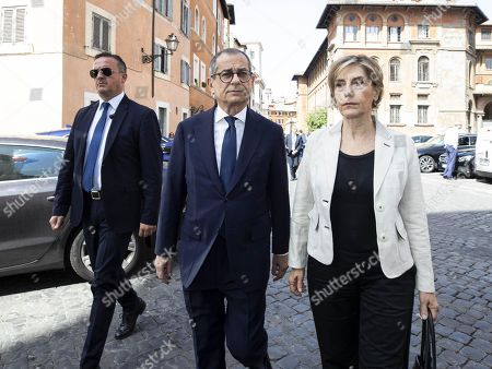 Italian Minister of Economy and Finance Giovanni Tria (C) along with his wife, Maria Stella Vicini, attend the funeral service of late Italian banker Fabrizio Saccomanni, in Rome, Italy, 12 August 2019. UniCredit chairman Fabrizio Saccomanni died on 08 August 2019 at the age of 76.