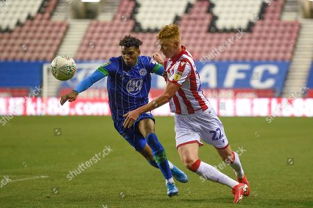 13th August 2019, DW Stadium, Wigan, England; Carabao Cup, Round 1, Wigan Athletic vs Stoke City ; Sam Clucas (22) of Stoke City and Dujon Sterling (15) of Wigan Athletic chase down the ball Credit: Richard Long/News Images English Football League images are subject to DataCo Licence