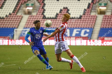 13th August 2019, DW Stadium, Wigan, England; Carabao Cup, Round 1, Wigan Athletic vs Stoke City ; Sam Clucas (22) of Stoke City chests the ball with Dujon Sterling (15) of Wigan Athletic pressuring Credit: Richard Long/News Images English Football League images are subject to DataCo Licence