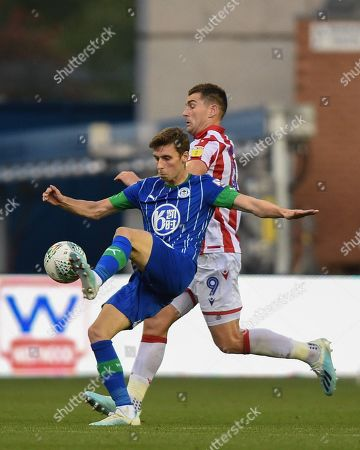 13th August 2019, DW Stadium, Wigan, England; Carabao Cup, Round 1,  Wigan Athletic vs Stoke City ; Joe Williams (20) of Wigan Athletic wins the challenge over Sam Vokes (9) of Stoke City  Credit: Richard Long/News Images English Football League images are subject to DataCo Licence