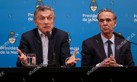 Argentine President Mauricio Macri, who is running for reelection, gives a press conference alongside his running-mate Miguel Angel Pichetto the day after primary elections at the government house in Buenos Aires, Argentina,. Macri was snubbed by voters who appeared to hand a resounding primary victory to a populist ticket with his predecessor, Cristina Fernandez de Kirchner
