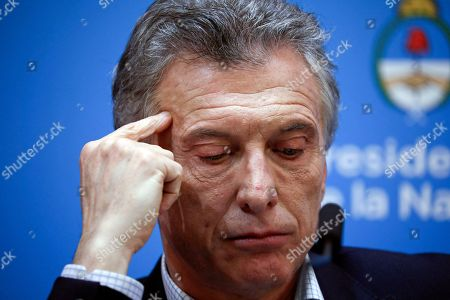 Argentine President Mauricio Macri, who is running for reelection, pauses during a press conference the day after primary elections at the government house in Buenos Aires, Argentina,. Macri was snubbed by voters who appeared to hand a resounding primary victory to a populist ticket with his predecessor, Cristina Fernandez de Kirchner