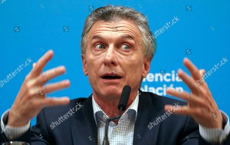 Argentine President Mauricio Macri, who is running for reelection, gives a press conference the day after primary elections at the government house in Buenos Aires, Argentina,. Macri was snubbed by voters who appeared to hand a resounding primary victory to a populist ticket with his predecessor, Cristina Fernandez de Kirchner