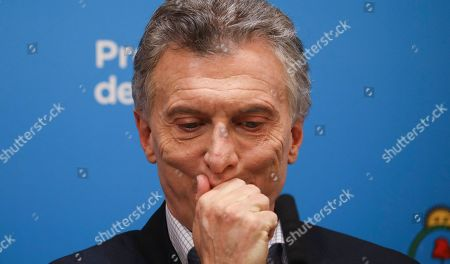 Argentine President Mauricio Macri, who is running for reelection, pauses during a press conference at the government house the day after primary elections in Buenos Aires, Argentina,. Macri was snubbed by voters who appeared to hand a resounding primary victory to a populist ticket with his predecessor, Cristina Fernandez de Kirchner
