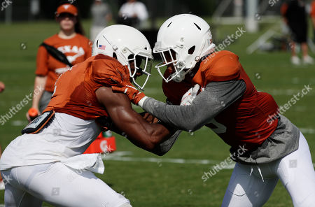 John Burt, Collin Johnson. Texas wide receiver John Burt, left, and wide receiver Collin Johnson, right, go through drills during a morning practice at the NCAA college football team's facility in Austin, Texas