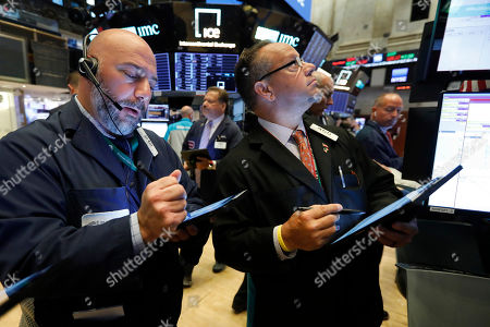 Vincent Napolitano, Robert Arciero. Traders Vincent Napolitano, left, and Robert Arciero work on the floor of the New York Stock Exchange,. Stocks are edging lower in early trading on Wall Street amid investor concerns that the U.S.-China trade war may be worsening