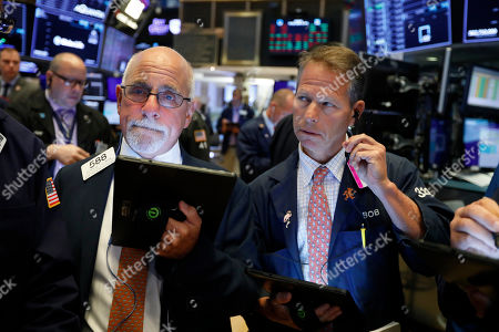 Peter Tuchman, Robert Charmak. Traders Peter Tuchman, left, and Robert Charmak work on the floor of the New York Stock Exchange, . Stocks are edging lower in early trading on Wall Street amid investor concerns that the U.S.-China trade war may be worsening