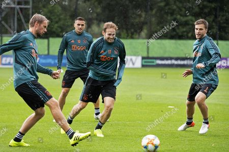 Daley Blind (2-R), Dusan Tadic, Siem de Jong (L) and Joel Veltman (R) in action during a training of Ajax Amsterdam, in Amsterdam, the Netherlands, 12 August 2019. Ajax is preparing for the return against PAOK for the third preliminary round soccer match of the UEFA Champions League on 13 August 2019.