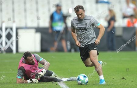 Xherdan Shaqiri of Liverpool rounds goalkeeper Andy Lonergan