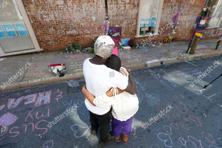 Aaliyah Jones, Kenny Winston. Aaliyah Jones, right, and Kenny Winston, both of Charlottesville, share a moment, at the memorial of their friend, Heather Heyer's death during the Unite the Right rally in 2017 in Charlottesville, Va