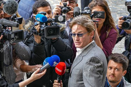 Benoit Magimel speaks to the press at the funeral of French film director Jean-Pierre Mocky at Saint Sulpice church