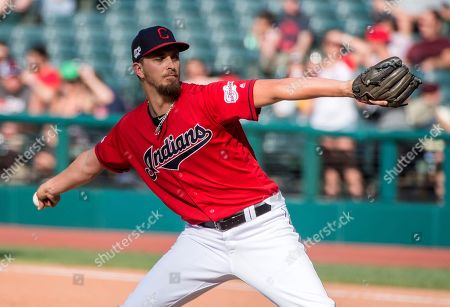 Cleveland Indians relief pitcher A.J. Cole delivers against the Texas Rangers during the second game of a baseball doubleheader in Cleveland