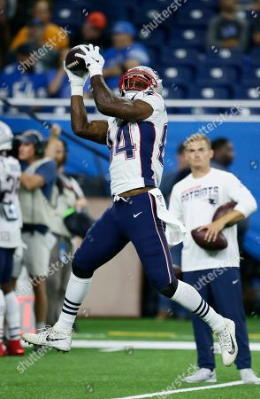 New England Patriots tight end Benjamin Watson (84) catches the ball during pregame of an NFL football game against the Detroit Lions, in Detroit