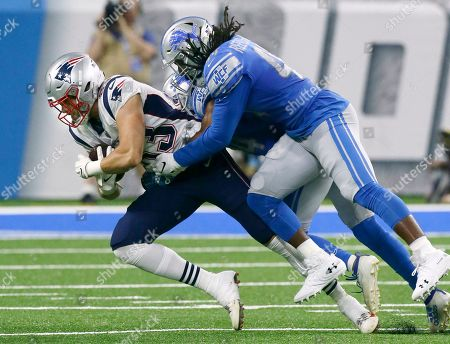 New England Patriots tight end Ben Watson is tackled by Detroit Lions linebackers Jalen Reeves-Mabin after making a catch during the first half of a preseason NFL football game, in Detroit