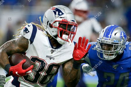 New England Patriots running back Brandon Bolden (38) carries the ball against Detroit Lions safety Andrew Adams (24) during the first half of a preseason NFL football game, in Detroit