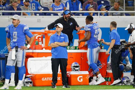Stock Photo of Detroit Lions head coach Matt Patricia talks with linebacker Devon Kennard (42) from behind the bench during an NFL preseason football game in Detroit