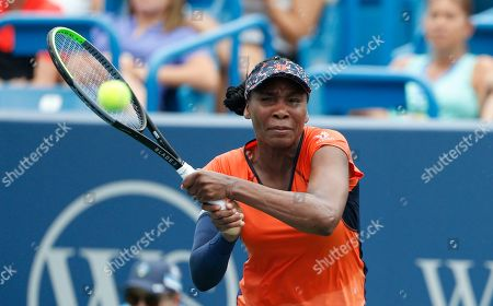 Stock Picture of Venus Williams returns a backhand against Lauren Davis during first round play at the Western & Southern Open tennis tournament, in Mason, Ohio