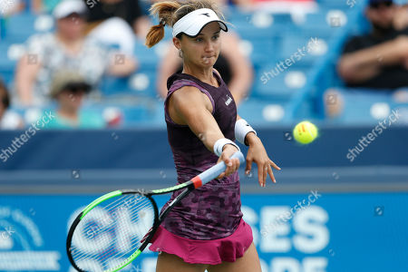Lauren Davis returns a forehand against Venus Williams during first round play at the Western & Southern Open tennis tournament, in Mason, Ohio