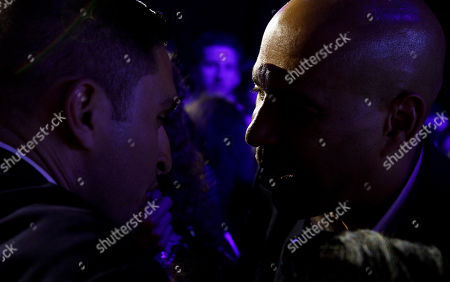 Democratic presidential candidate Senator Corey Booker (R), of New Jersey, greets supporters during a happy hour campaign event in New York, New York, USA, 12 August 2019.